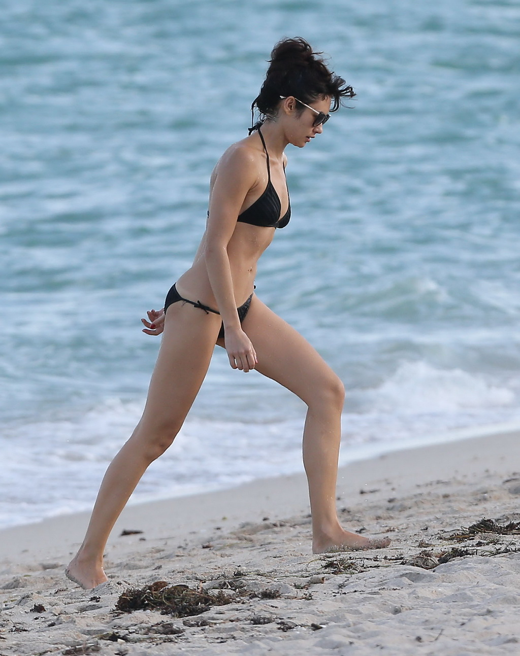 shows off her hot body wearing wet black bikini at the beach in miami