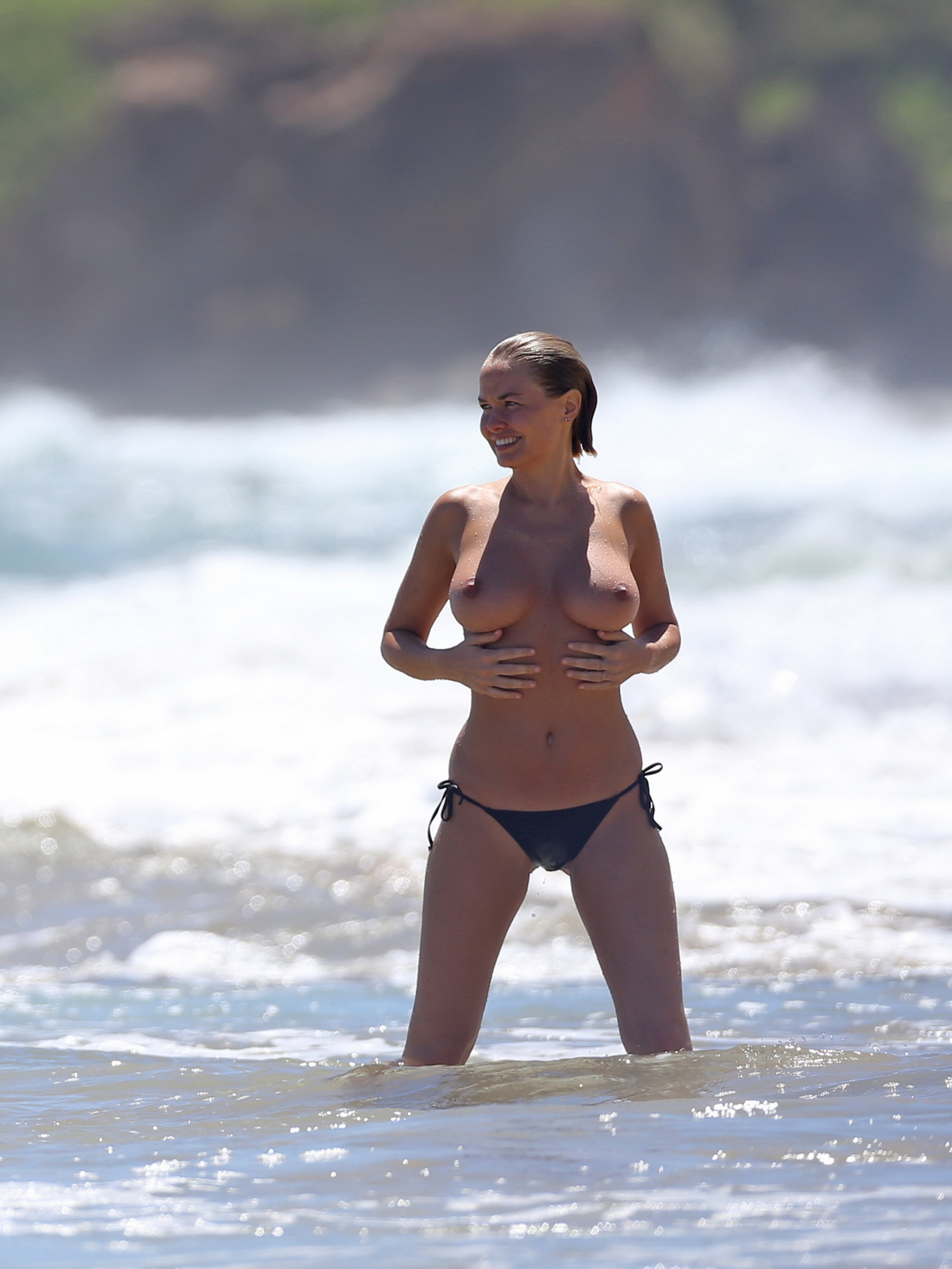 Lara Bingle showing off her fully naked body during a ...